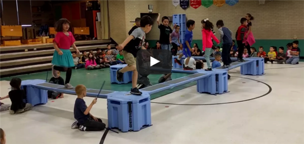 students participate in an obstacle course